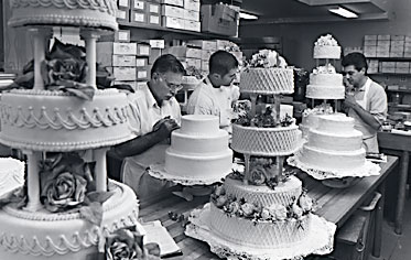 Decorators putting final touches on wedding cakes. Let us create the perfect cake for your special day!