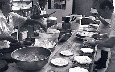 Master bakers at work using old-world craftsmanship -- everything is handmade with attention to detail.